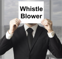 businessman in black suit hiding face behind sign whistle blower